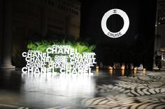An oversize life preserver and black and white beach balls provided a backdrop for the step-and-repeat at the entrance to the event.