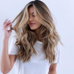 Long hair with face framing layers and golden blonde balayage highlights. http://www.bornwithit.com.au/