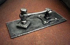 Forged steel door knocker.