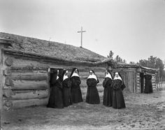 These nuns served at St. Labre Mission in Ashland, Montana. Left to right: Sisters Gertrude, Barbara, and Monica, Mother Mary of the Angels, sisters Thecla and Hildegarde, Father Vermaat. Photo by L. A. Huffman