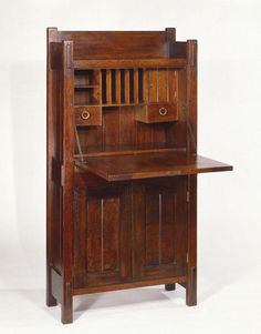 Gustav Stickley (1857-1942). Dropfront Desk, Open Medium: Oak with copper hardware Dates: ca. 1903