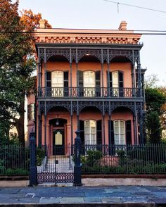 Louisiana French style, with raised stone or brick basement to protect from floods, balconies with lacey ironwork, and hip roof with two chimneys; white stucco walls are also common - style originated in New Orleans Louisiana Homes, New Orleans Louisiana, Victorian Terrace, Victorian Homes, Amazing Architecture, Architecture Details, Architecture Images, Beautiful Buildings, Beautiful Homes