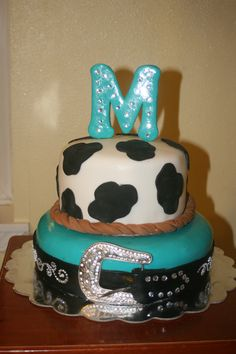 Cake I made my daughter for her 17th birthday.  All fondant except buckle.  Used self stick rhinestone stickers for bling.