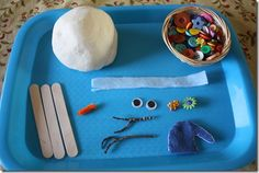 Tot tray with Snow Play Dough and all the accessories needed for building your own snowman.  Love it!