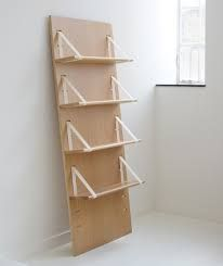 shelves + decorative plywood backboard. bookshelf between sofa and sideboard