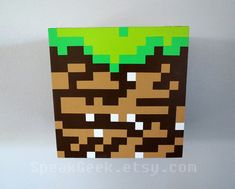*****This is a MADE TO ORDER item. Please allow up to 4-6 weeks for this to be made before it is shipped.***** A Minecraft Dirt block shelf will be a perfect addition to your room! This shadow box shelf has been meticulously hand painted to replicate the dirt block from the Minecraft video