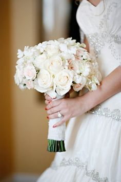 Bridal bouquet with similar shades of white and ivory but lots of different textures.