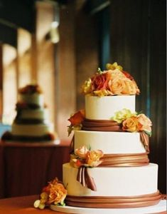 fall colored wedding cake-a tad lighter and it will be the same color as the sash on my dress!!!  add purple flowers instead of red, PERFECT