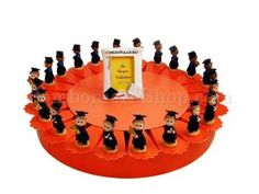 22 Slice favour cake decorated with male graduating figurines a filled with a choice of italian dragees. This is a wonderful idea for a graduation degree party favor centre piece display. Italian bomboniere. #favour #favor #graduation #degree http://www.bombonierashop.com/en/department/12/Favour-Cakes.html