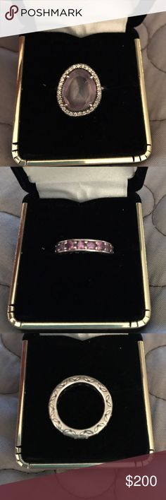 Pandora stackable rings Pandora stackable rings. Band is sterling silver with ornate pattern engraved on outside edges. Featuring sparkling purple stones all the way around the band. The second band is also sterling silver, featuring a large purple spinel encircled by clear cubic zirconia. Pandora Jewelry Rings