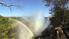 Double rainbow at the Victoria Falls, Zambia. The Victoria Falls is one of the Seven Natural Wonders of the World and a UNESCO World Heritage Site. Victoria Falls, Natural Wonders, Niagara Falls, Wonders Of The World, Waterfall, Destinations, Rainbow, Travel, Outdoor