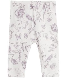These sweet leggings feature a lovely fairytale floral pattern for a whimsical finish. Made from super soft cotton perfect for layering over bodysuits. ### Small Newbie label  Fabric: 100% CottonWash: 40ºKeep away from fire