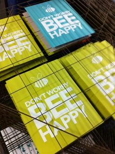 Printed posters on the drying rack. Don't Worry Bee Happy