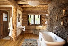 Rustic bathroom in stone and wood with a snug corner bench