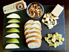 BellaVitano Gold® with mixed nuts, pears, French bread, dried pineapple