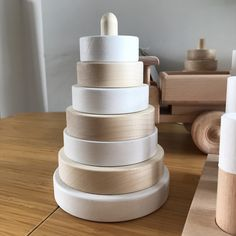 Our new pyramid ring stacker in white and raw wood! Perfect gift idea for both boys and girls 😊 Baby Gift Sets, Baby Gifts, Geometric Box, Learning Colors, Learning Toys, Stacking Toys, Wooden Train, Non Toxic Paint, Waldorf Toys