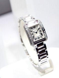 Cartier Tank watch. Every women Should own a solid luxury watch.