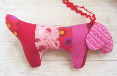 Dog toy baby patchwork soft dachshund wiener sausage dackel red pink dots roses hand embroidered nose eyes rick rack ribbon leash kids gift by poppyshome on Etsy