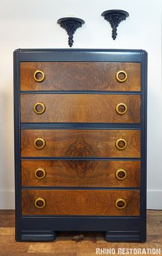 Art Deco Waterfall Dresser with Round Bakelite drawer pulls. Awesome. Drawer front refinished. Hardware cleaned. The frame is painted a warm navy with lacquer finish. rhino-restoration.com