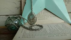 Check out this item in my Etsy shop https://www.etsy.com/listing/273046874/vintage-teardrop-pendant-necklace-on