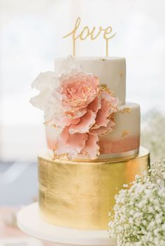 Pink and gold wedding cake: This dessert idea always looks stunning in wedding photos. The alternating colors in each layer with blush floral decorations and a calligraphy cake topper look gorgeous altogether.