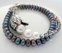Pretty peacock and ivory coloured freshwater pearls, with  Silver and Swarovski crystals.