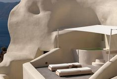 A cliffside boutique hotel on the elegant island of Santorini, Mystique offers a pocket of modern luxury and natural serenity in a sublime, primeval landscape.