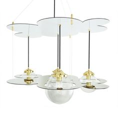 Two parallel tiers of precision cut mirrored panels house four beautiful globe pendant lights of the Combe chandelier.