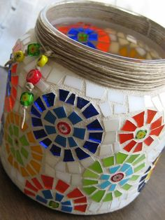 Mosaic pot with unique twine and bead decoration. I don't know who made this, but it is stunning. Mosaic Planters, Mosaic Vase, Mosaic Tile Art, Mosaic Flower Pots, Tile Crafts, Mosaic Crafts, Mosaic Projects, Stained Glass Designs, Mosaic Designs