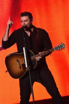 "Chris Young Photos - Chris Young in Concert - Zimbio  Chris Young performs during the Chris Young ""I'm Comin' Over"" World Tour at Ascend Amphitheater on September 30, 2015 in Nashville, Tennessee."