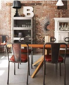 Black, white, exposed brick. Accents of oxblood red and warm wood.