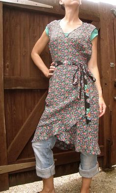 wrap apron worn over jeans, by Susannah Dashwood