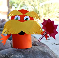 Learn how to make a lorax toilet paper roll craft for kids. It is an easy Dr. Suess art project to do for Dr. Suess Day.