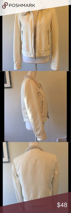 Theory faux fur white jacket medium zip pockets Such a cute jacket! It had a stain by the right front  pocket so I had it dry cleaned and they were able to get it out but there is a Teeny Tiny extremely faint spot still left as shown in close up photo. Not noticeable at all! Theory Jackets & Coats
