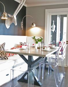 wood and metal table built in bench banquette seating ghost chairs charcoal wall color ram head