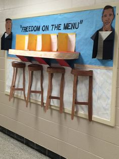 "Black History Month bulletin board based the book ""Freedom on The Menu."""