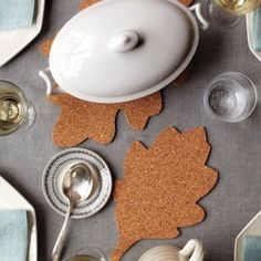 trivets made from cork...could make these with the sheets they sell at the dollar store and stack them for thickness