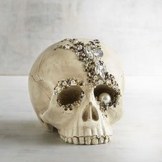 Halloween decor handcrafted skull as some nice bling going on with a pearl and sparkle jewels. Place it on a mantel, shelf or console table. ad link