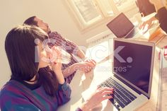 Young group of people/architects discussing business plans royalty-free stock photo