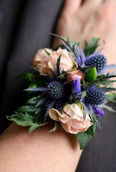 Peach rose and blue thistle wrist corsage