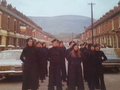 Members of the Official IRA in West Belfast, 1976, prepare for an Easter Commemoration event.