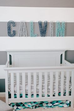 This modern nursery is so cool! Love the name over the crib with the wide stripe painted walls. Great for a bedroom that can grow with your child.