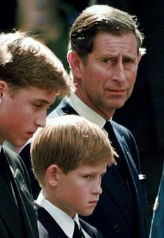 Princes' William and Harry with their father, Prince Charles, outside of Westminster Abbey after Diana's funeral on September 6, 1997