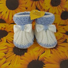 Knitted baby booties- blue and white $9.99 Our Knitted baby booties keep your baby's little feet warm and comfy. They're knitted from soft wool that doesn't irritate your baby's skin. Material: 100 % Acrylic. Sizes from Newborn to 12 months.
