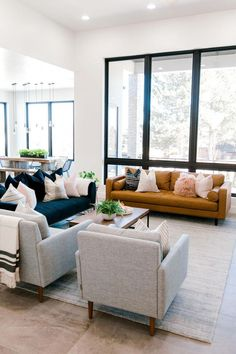 modern meets traditional living room with leather sofa and open floor plan Influencer: Kailee Wright Designer: Ashley Cooper Photographer: Aubrey Taiese Home Interior, Home Living Room, Interior Design Living Room, Living Room Designs, Interior Decorating, Apartment Living, Decorating Ideas, Blue Couch Living Room, Living Room Decor Trends 2018