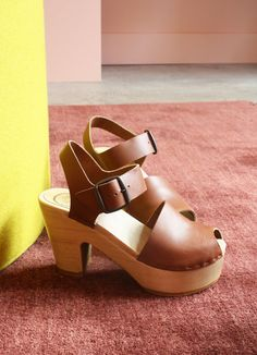 Description: The classic minimal Jane Clog from No. 6 with a hip platform base. Fit: Leather will soften and give with wear. This shoe runs big. Please go down a whole size. US size (No.6 size) 5 (35) 5.5 (35) 6 (36) 6.5 (36) 7 (37) 7.5 (38) 8 (38) 8.5 (39) 9 (39) 9.5 (40) 10 (40) 10.5 (41) 11 (41) Designer: No.6 Details: 100% leather upper 4 heel with 1 3/4 front platform Lacquered wooden base with rubber sole Handmade in the United States by No.6 Platforms are No.6's most generous ...