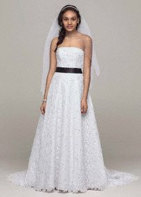 """Allover beaded corded lace A-line gown. Chapel train. Available in White or Ivory. Also available without train as Style NT2406 (special order only). Shown with 2"""" satin ribb... Learn more"""