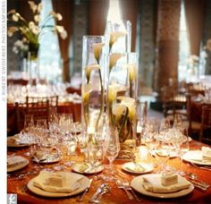 Deepa and Greg chose three different centerpieces, all with white calla lilies. The highest ones were arrangements of long-stemmed lilies tied to the top of cylinder vases.