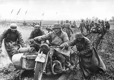 """Wehrmacht coping with the muddy conditions of the """"Rasputitsa"""" or muddy season in Russia."""