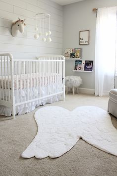 I've wanted a shiplap wall (or walls!!) in my house since I saw the first episode of Fixer Upper a couple of years ago...and a sweet little nursery seemed like the perfect excuse to make that happen! My other two kids' nurseries had themes and were very well thought-out, but this one...not so much. All I knew was that I wanted it to be light, bright and airy...and when I started incorporating things that fit that description, it all just kind of fell into place!
